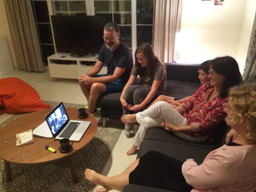 Family of homeschoolers watch the 'Class Dismissed' documentary together in Dubai.